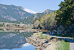 woman walking dog around Lake Estes, Estes Park, Colorado, USA