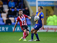 Lincoln City's Neal Eardley clears under pressure from Shrewsbury Town's David Edwards<br /> <br /> Photographer Andrew Vaughan/CameraSport<br /> <br /> The EFL Sky Bet League One - Shrewsbury Town v Lincoln City - Saturday 11th January 2020 - New Meadow - Shrewsbury<br /> <br /> World Copyright © 2020 CameraSport. All rights reserved. 43 Linden Ave. Countesthorpe. Leicester. England. LE8 5PG - Tel: +44 (0) 116 277 4147 - admin@camerasport.com - www.camerasport.com