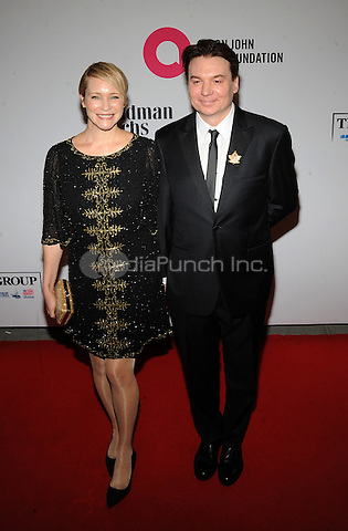 New York,NY- October 28: Kelly Tisdale, Mike Myers attends the Elton John AIDS Foundation's 13th Annual An Enduring Vision Benefit at Cipriani Wall Street on October 28, 2014 in New York City In New York City on October 27, 2014 . Credit: John Palmer/MediaPunch
