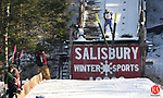 SALISBURY, CT- 07 February 2009 --020709JS14-Spectators look on as Matt Doyle takes to the air Saturday at Satre Hill in Salisbury during the Salisbury Winster Sports Association Jump Fest 2009. The event continues today with the U.S. Eastern National Chapionships. <br /> Jim Shannon / Republican-American
