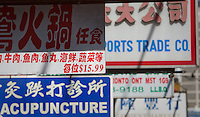 Various signs written mostly in Chinese are seen in Toronto Chinatown April 23, 2010. Toronto Chinatown is an ethnic enclave in Downtown Toronto with a high concentration of ethnic Chinese residents and businesses extending along Dundas Street West and Spadina Avenue.