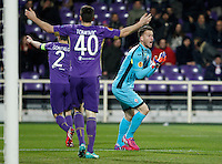 Calcio, Europa League: Andata degli ottavi di finale Fiorentina vs Roma. Firenze, stadio Artemio Franchi, 12 marzo 2015.<br /> From left, Fiorentina's Gonzalo Rodriguez, Nenad Tomovic and Norberto Neto gesture during the Europa League round of 16 first leg football match between Fiorentina and Roma at Florence's Artemio Franchi stadium, 12 March 2015.<br /> UPDATE IMAGES PRESS/Isabella Bonotto