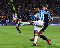 Huddersfield Town's Elias Kachunga clears under pressure from Burnley's James Tarkowski<br /> <br /> Photographer Andrew Kearns/CameraSport<br /> <br /> The Premier League - Huddersfield Town v Burnley - Wednesday 2nd January 2019 - John Smith's Stadium - Huddersfield<br /> <br /> World Copyright © 2019 CameraSport. All rights reserved. 43 Linden Ave. Countesthorpe. Leicester. England. LE8 5PG - Tel: +44 (0) 116 277 4147 - admin@camerasport.com - www.camerasport.com