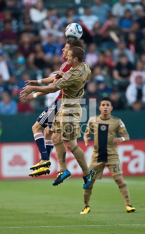 Chivas USA midfielder Blair Gavin (18) goes up to head ball against Philadelphia Union defender Jordan Harvey (2) during the first half of the game between Chivas USA and the Philadelphia Union at the Home Depot Center in Carson, CA, on July 3, 2010. Chivas USA 1, Philadelphia Union 1.