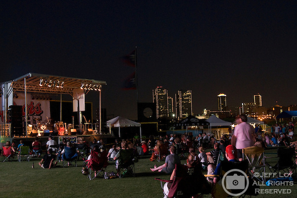 With the downtown Fort Worth, Texas skyline in the distance, music fans wait for the Austin, Texas based band Reckless Kelly to take the stage during Mayfest at LaGrave Field in Fort Worth, Texas on July 12, 2009. ..The July concert was a makeup event after the original festival was canceled amid fears concerning the H1N1 (swine) influenza (Swine flu) outbreak.