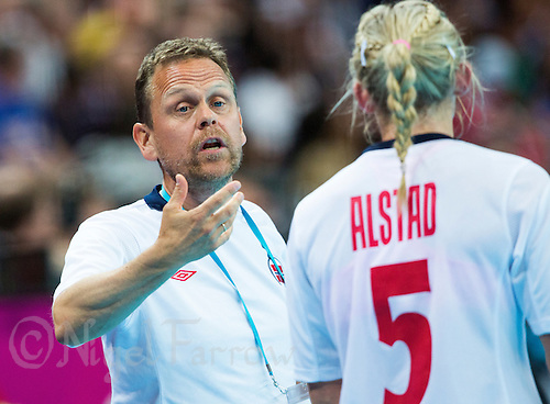 11 AUG 2012 - LONDON, GBR - Norway coach Thorir Hergeirsson (NOR) gives instructions to Ida Alstad (NOR) during the women's London 2012 Olympic Games handball final against Montenegro in the Basketball Arena in Olympic Park, in Stratford, London, Great Britain(PHOTO (C) 2012 NIGEL FARROW)