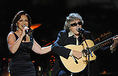 """Washington, DC - October 13, 2009 -- Gloria Estefan (L) and Jose Feliciano perform at a White House Music Series """"Fiesta Latina"""" with United States President Barack Obama on the South Lawn of the White House in Washington on October 13, 2009. .Credit: Alexis C. Glenn / Pool via CNP"""