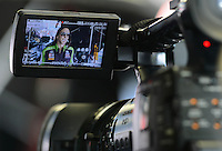 Sept. 28, 2012; Madison, IL, USA: NHRA funny car driver Alexis DeJoria is shown on back of TV camera during qualifying for the Midwest Nationals at Gateway Motorsports Park. Mandatory Credit: Mark J. Rebilas-