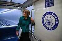 Senator Lisa Murkowski, Republican of Alaska, speaks with a reporter as she enters the Senate Subway on Capitol Hill in Washington, DC on February 6, 2019. Credit: Alex Edelman / CNP/AdMedia