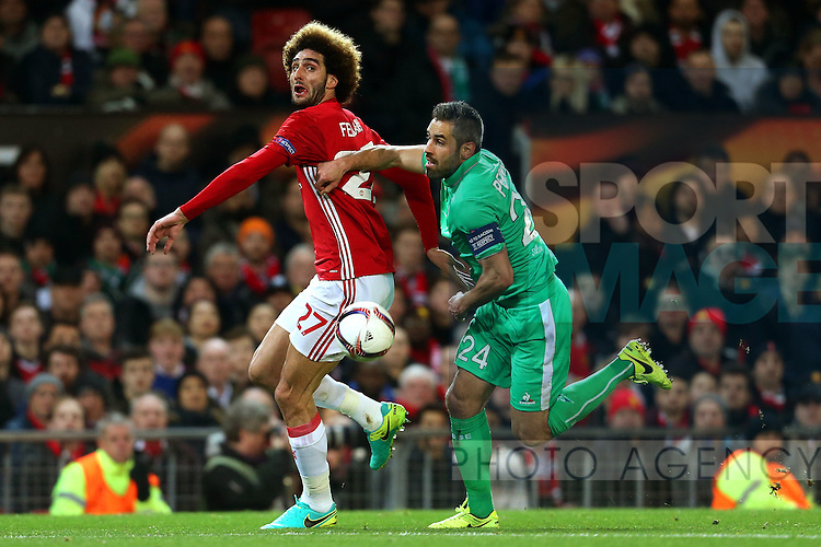 Loic Perrin of Saint Etienne challenges Marouane Fellaini of Manchester United during the UEFA Europa League Round of 32 1st leg match at Old Trafford Stadium, Manchester. Picture date: February 16th, 2017. Pic credit should read: Matt McNulty/Sportimage