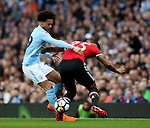 Leroy Sane of Manchester City tackles Luis Antonio Valencia of Manchester United during the premier league match at the Etihad Stadium, Manchester. Picture date 7th April 2018. Picture credit should read: Simon Bellis/Sportimage
