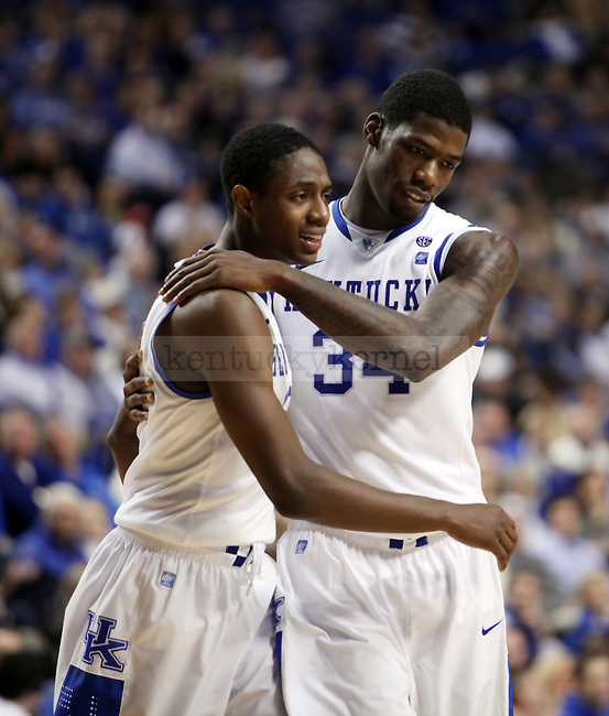 DeAndre Liggins hugs Brandon Knight in the second half of UK's win over the Penn Quakers at Rupp Arena on Jan. 3, 2011. Photo by Britney McIntosh | Staff