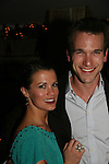 Melissa Claire Egan and Adam Mayfield at Marcia Tovsky's Holiday/Bon Voyage Party for AMC on December 1, 2009 at Nikki Midtown, New York City, New York. (Photo by Sue Coflin/Max Photos)