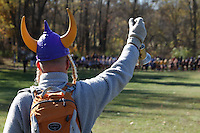 A Francis Howell Vikings fan rings a bell at the start of the Class 4 Sectional 1 girls race.