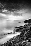 British coastal scene with rocky coastline looking out to sea with long exposure