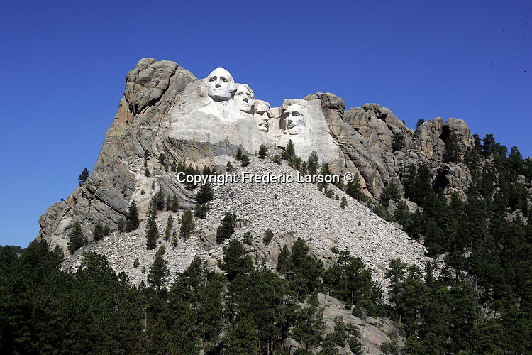 From George Washington left ear to Lincoln chin, all four Rushmore Presidents would fit in just the fave of Crazy Horses..