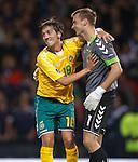 Deividas Cesnauskas celebrates with Lithuania keeper Zydrunas Karcemarskas as he saves the Scotland captain's penalty kick