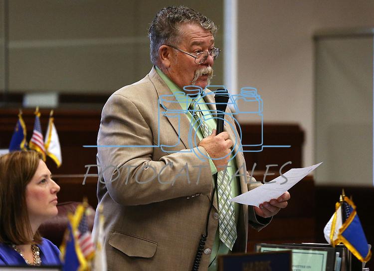 Nevada Sen. Pete Goicoecheae, R-Eureka, talks on the Senate floor at the Legislative Building, in Carson City, Nev., on Friday, Feb. 20, 2015. Sen. Becky Harris, R-Las Vegas, is at left.<br /> Photo by Cathleen Allison