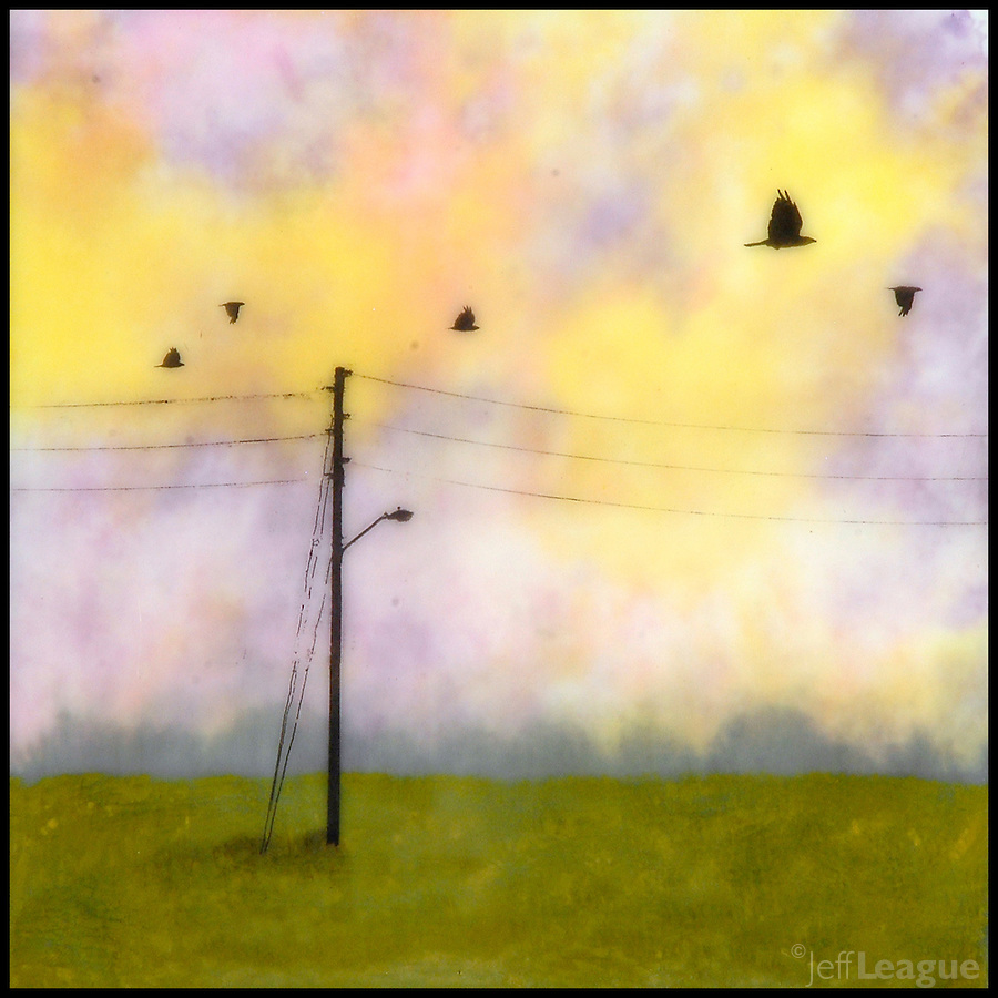 Mixed media encaustic photo painting of birds flying over field with telephone poles