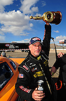 Apr. 1, 2012; Las Vegas, NV, USA: NHRA top alcohol funny car driver Tony Bartone celebrates after winning the Summitracing.com Nationals at The Strip in Las Vegas. Mandatory Credit: Mark J. Rebilas-