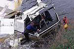 Drogheda Firebirgade Divers who released the body of the Lorry Driver after cutting the cab and spreading it apart. The remains of the Lorry that crashed on the N2 at slane bridge. The lorry roaled over after crashing through the bridge wall and falling over thirty feet into the river Boyne. The lorry driver died soon after the crash before rescuers could reace him..Picture Fran Caffrey Newsfile