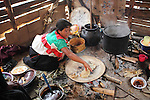 A Native nahuatl woman puts tamales on a comal in her village of Acaxochitlan village, in northern state of Hidalgo, during the festivities of the Day of the Deads. Hundreds of Native villages pay homage to their deads on the eve of November 2 as a tradition since the preHispanic times. Photo by Heriberto Rodriguez