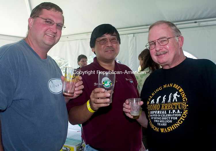 OXFORD, CT- 23 AUGUST 2008- 082308JT10-<br /> From left, Paul Adam of Danbury with Hogan Eng and Peter Hauser of Woodbury at Cork &amp; Keg of Southbury's 2008 Summer Beer Festival at the Golf Club at Oxford Greens on Saturday. Thirty-nine brewers from around the country were there, along with Head Chef Chris Holt. Cork &amp; Keg chose Easter Seals in Waterbury, which serves people with disablilites and special needs, as their charitable benefactor.<br /> Josalee Thrift / Republican-American
