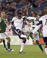 New England Revolution midfielder Shalrie Joseph (21) volleys a pass as Portland Timbers midfielder Jeremy Hall (17) defends. In a Major League Soccer (MLS) match, the New England Revolution tied the Portland Timbers, 1-1, at Gillette Stadium on April 2, 2011.