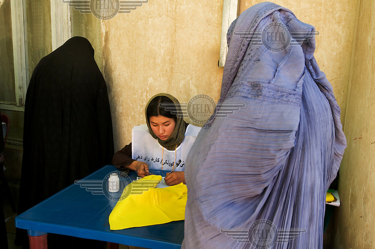 A woman registers to vote in the 2009 Afghan election.