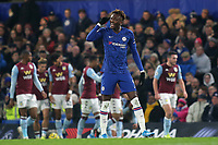 Chelsea's Tammy Abraham makes a gesture to his defence as Aston Villa celebrate their opening goal in the background during Chelsea vs Aston Villa, Premier League Football at Stamford Bridge on 4th December 2019