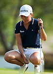 CHON BURI, THAILAND - FEBRUARY 20:  In Kyung Kim of South Korea reacts to her put on the 17th green during day four of the LPGA Thailand at Siam Country Club on February 20, 2011 in Chon Buri, Thailand. Photo by Victor Fraile / The Power of Sport Images