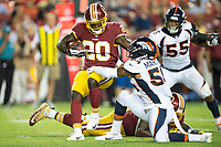 Landover, MD - August 24, 2018: Washington Redskins running back Rob Kelley (20) is tackled by Denver Broncos linebacker Brandon Marshall (54) during preseason game between the Denver Broncos and Washington Redskins at FedEx Field in Landover, MD. The Broncos defeat the Redskins 29-17. (Photo by Phillip Peters/Media Images International)