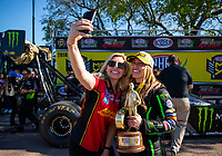 Apr 22, 2018; Baytown, TX, USA; NHRA top fuel driver Brittany Force (right) poses for a selfie portrait with sister Courtney Force as they celebrate after winning the Springnationals at Royal Purple Raceway. Mandatory Credit: Mark J. Rebilas-USA TODAY Sports