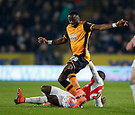 Adama Diomande of Hull City tackled by Joel Campbell of Arsenal - English FA Cup - Hull City vs Arsenal - The KC Stadium - Hull - England - 8th March 2016 - Picture Simon Bellis/Sportimage