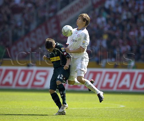 24.4.2010 Bundesliga Matchday 32, League 1 Borussia Moenchengladbach v  FC Bayern Munich. The match resulted in a 1 all draw.l Patrick Herrmann left Gladbach against Holger Badstuber Munich
