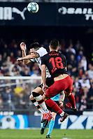 14th February 2020; Mestalla, Valencia, Spain; La Liga Football,Valencia versus Atletico Madrid; Felipe of Atletico Madrid challenges for a high ball with Maxi Gomez of Valencia CF