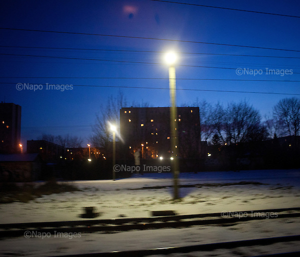 LODZ, FEBRUARY 2012:.View of sleeping town at 4:30 from train to Warsaw. About 500 thousand people commute everyday from other towns and villages to work in the Polish capital..(Photo by Piotr Malecki / Napo Images)..Lodz, Luty 2012:.Widok z pociagu do Warszawy o 4:30 rano. Okolo 500 tysiecy osob dojezdza codziennie z innych miast do pracy w Warszawie.  .Fot: Piotr Malecki / Napo Images