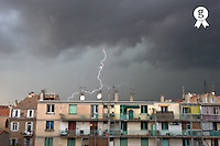 Lightning storm over buildings, Marseille (Licence this image exclusively with Getty: http://www.gettyimages.com/detail/88091100 )