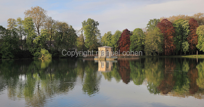 Carp Pond with the octagonal pavilion, built 1662 by Le Vau and restored 1807 in the gardens of the Chateau of Fontainebleau, France. The Palace of Fontainebleau is one of the largest French royal palaces and was begun in the early 16th century for Francois I. It was listed as a UNESCO World Heritage Site in 1981. Picture by Manuel Cohen