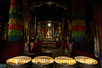 Images from the Book Journey Through Colour and Time, A buddhist Monk looking after the Butterlamps, inside the temple, Lhasa