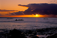 Three Canoes at sunset from Kaanapali beach, Maui, with view of Island of Molokai in distance