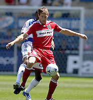 Chicago Fire foward Brian McBride (20) handles the ball while being pressured by FC Dallas defender Anthony Wallace (26).  FC Dallas defeated the Chicago Fire 3-0 at Toyota Park in Bridgeview, IL on May 31, 2009.