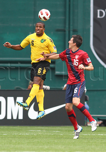 19.06.2011. Washington, USA.  Sacha Kljestan (16) of  USA loses out on a header to Jermaine Taylor (6) of Jamaica during a CONCACAF Gold Cup quarter-final match at RFK stadium in Washington D.C. USA won 2-0.