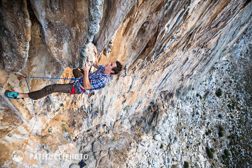 Climbing at the Panorama Wall on the route Super Carpe Diem, 7b+, Kalymnos, Greece.