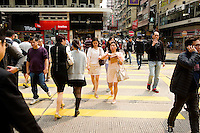 HONG KONG - MARCH 03: Young fashionistas and a crowd of people cross the street in Mong Kok busy neighborhood, on March 3, in Hong Kong. (Photo by Lucas Schifres/Pictobank)