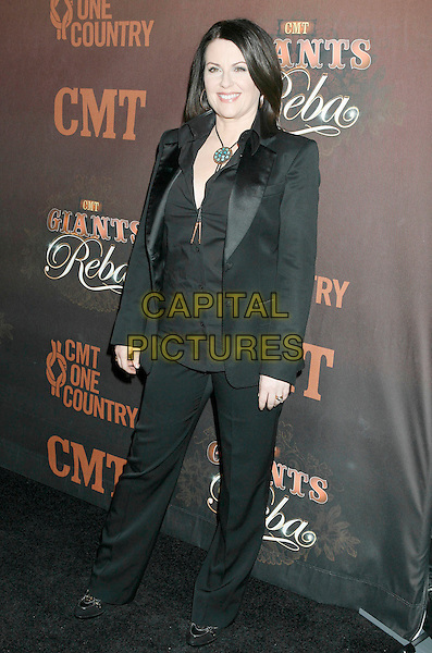 "MEGAN MULLALLY.Arrivals at ""CMT Giants"" Honoring Reba McEntire held at the Kodak Theatre, Hollywood, LA, California, USA,.26 October 2006..full length black suit.Ref: ADM/RE.www.capitalpictures.com.sales@capitalpictures.com.©Russ Elliot/AdMedia/Capital Pictures."