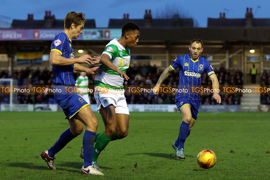 Tahvon Campbell of Yeovil in action as AFC Wimbledon's Paul Robinson and Barry Fuller look on during AFC Wimbledon vs Yeovil Town, Sky Bet League 2 Football at the Cherry Red Records Stadium