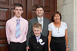 Kyle Cluskey who made his First Communion at Our Lady of Lourdes Church on Saturday 16th May, pictured with dad Michael, mum Elaine and older brother Mark.