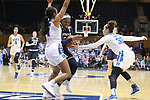 DURHAM, NC - FEBRUARY 04: Notre Dame's Arike Ogunbowale (center) is defended by Duke's Lexie Brown (4) and Jayda Adams (32). The Duke University Blue Devils hosted the University of Notre Dame Fighting Irish on February 4, 2018 at Cameron Indoor Stadium in Durham, NC in a Division I women's college basketball game. Notre Dame won the game 72-54.