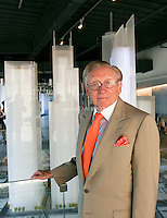Tenth anniversary of 9/11.  Rebuilding at the World Trade Center site.  Developer and World Trade Center lease-holder, Larry A. Silverstein,   President and CEO of Silverstein Properties.  Scale model shows L to R: 4 WTC, 3 WTC and 2 WTC, buildings which he controls.   Photo by Ari Mintz.  8/22/2011.